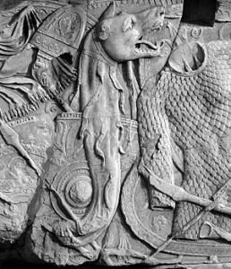 """Dacische wapenrustingen. De falx, het sikkelachtige wapen van de Daciërs, was zo effectief dat de Romeinen hun uitrusting erop aan moesten passen. De Dacische """"Draco"""" (draakvormige vlag) werd in de Laat-Romeinse tijd een gebruikelijk Romeins vaandel."""