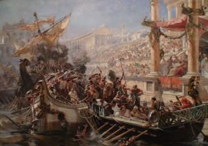 """""""Morituri te salutant!"""" Claudius was dol op gladiatorengevechten, met name op nagespeelde zeeslagen. (Detail van La Naumaquia door Ulpiano Checa.)"""