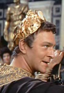 Christopher Plummer als Commodus in de film the Fall of the Roman Empire (1964). In deze film blijkt de boosaardige Commodus tot zijn schrik een buitenechtelijk kind van keizerin Faustina en een gladiator, een gerucht dat tijdens het echte leven Commodus ook ging.