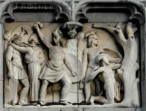Reliëf van het Luikse paleis van de Prins-bisschoppen waarop is afgebeeld hoe Ambiorix met zijn mannen de Romeinen aanvalt. Let op hoe de krijger rechts van hem bewapend is met een slinger.